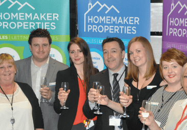 The Homemaker Properties team toasting the new Earlsdon shop